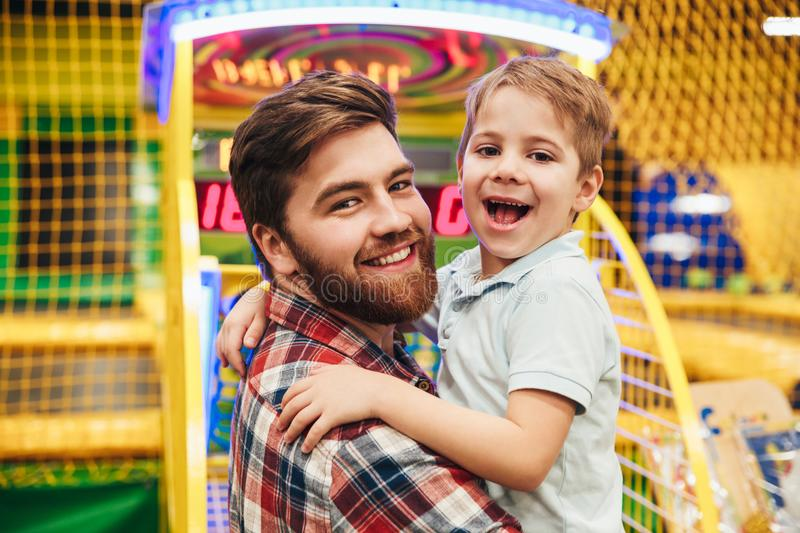 Cheerful little boy having fun with his dad royalty free stock image