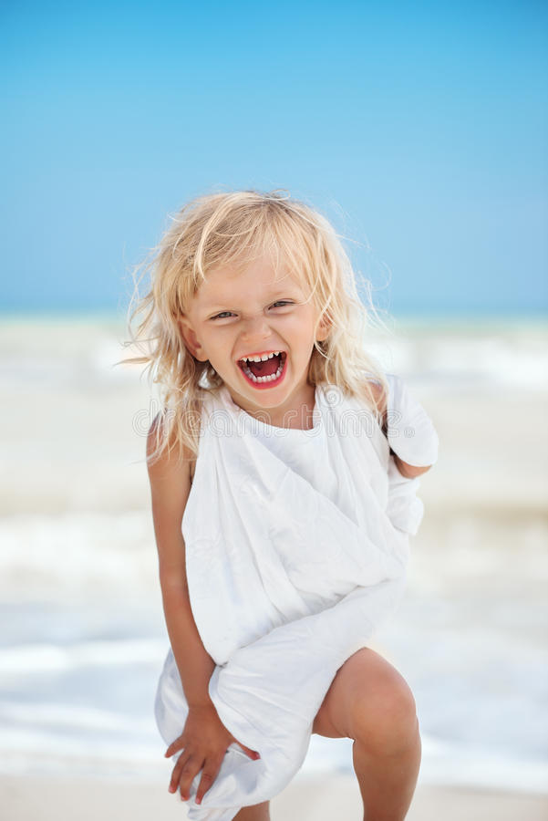 Cheerful little caucasian girl stock photo