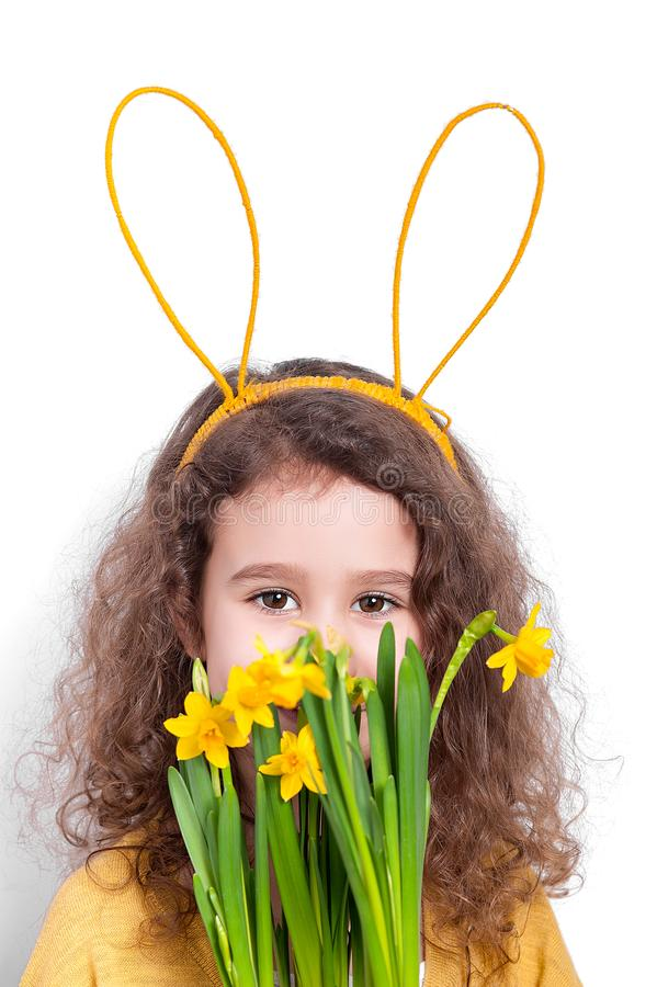 Girl with bunny ears with flowers on a light background stock photo