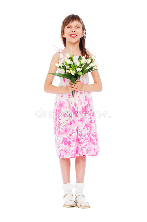 Cheerful little girl with bunch of tulips