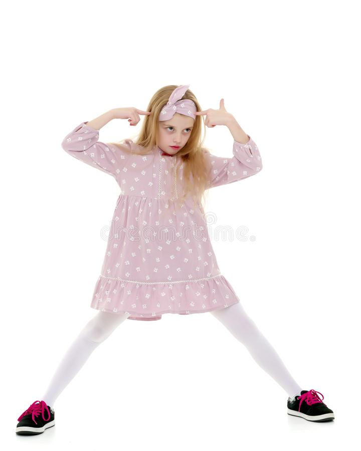 A cheerful little girl is dancing. royalty free stock photos