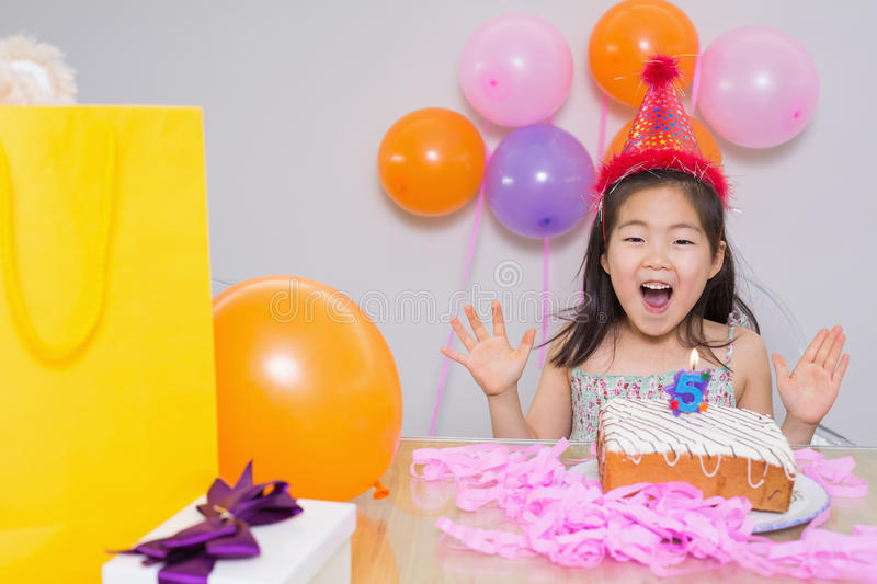 Cheerful little girl at her birthday party. Closeup of a cheerful surprised little girl at her birthday party stock photos