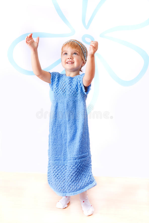 Cheerful Little Girl In Knitted Blue Dress Royalty Free Stock Photo
