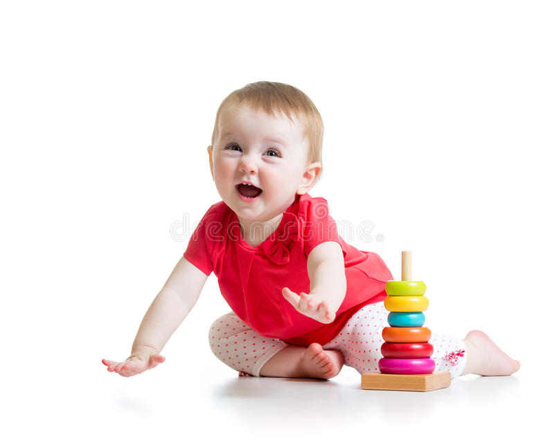 Cheerful little girl playing with colorful toy royalty free stock photography