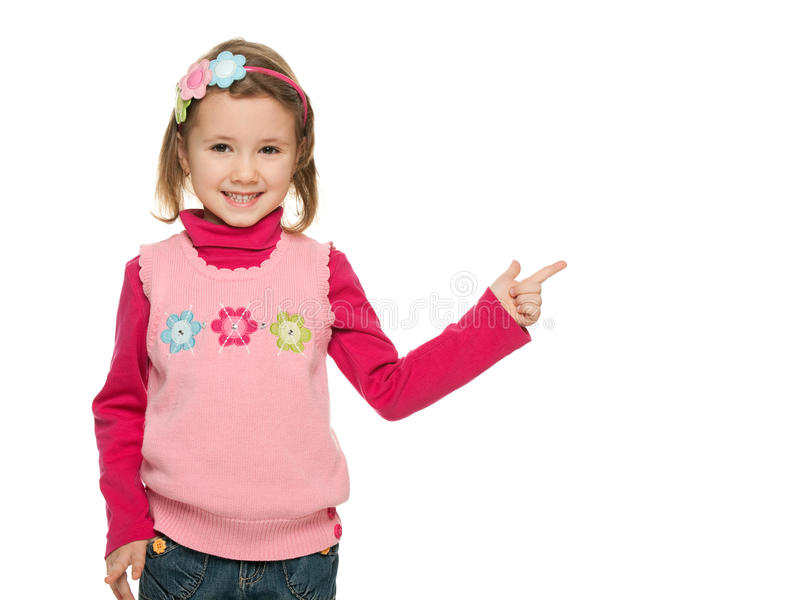 Cheerful little girl points finger at something stock photos