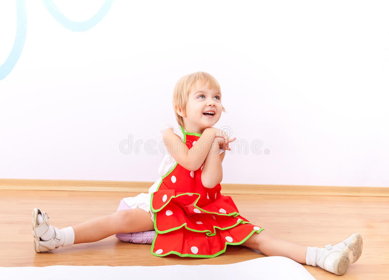 Download Cheerful Little Girl In Red Apron Stock Photo - Image: 22154600