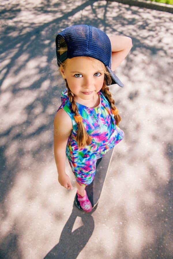 Kid riding on skateboard royalty free stock photo