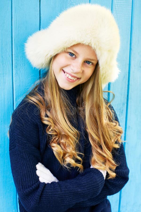 Cheerful little girl in warm sweater. royalty free stock photo