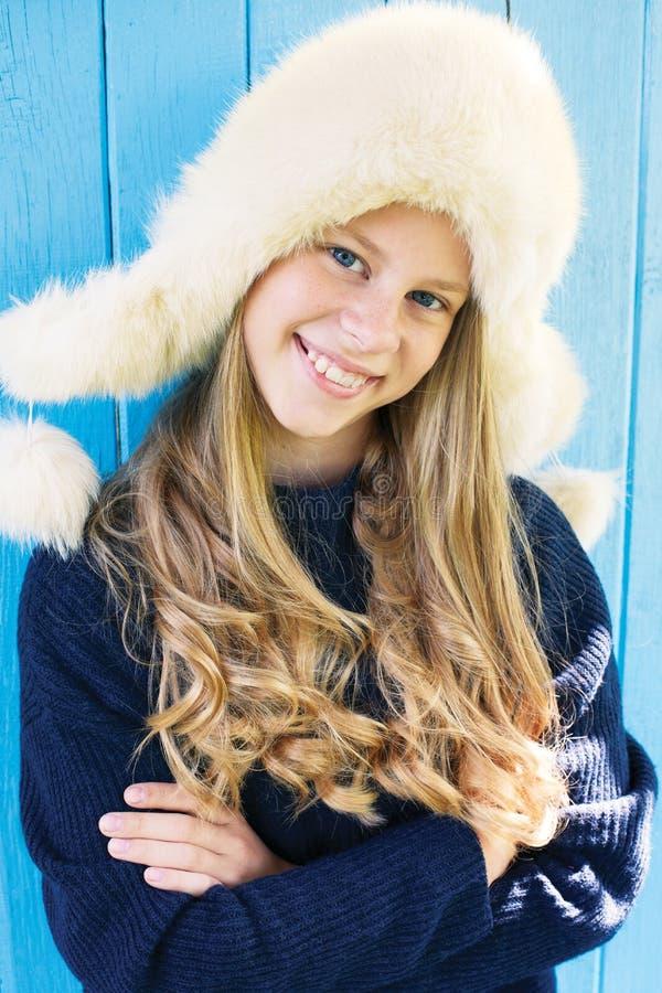 Cheerful little girl in warm sweater. stock photos