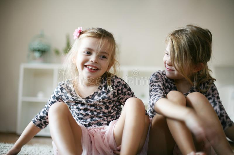 Cheerful little girls. stock images