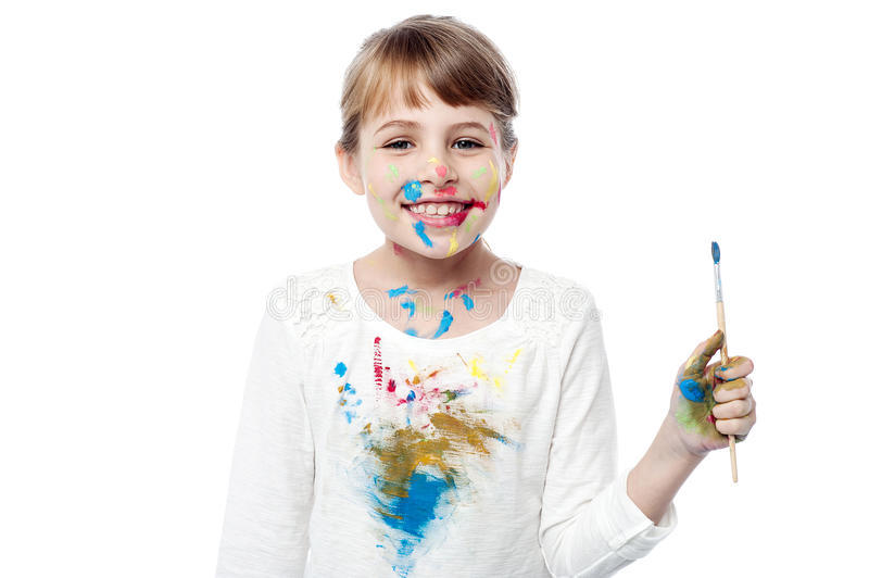 Cheerful little messy girl painter stock photography