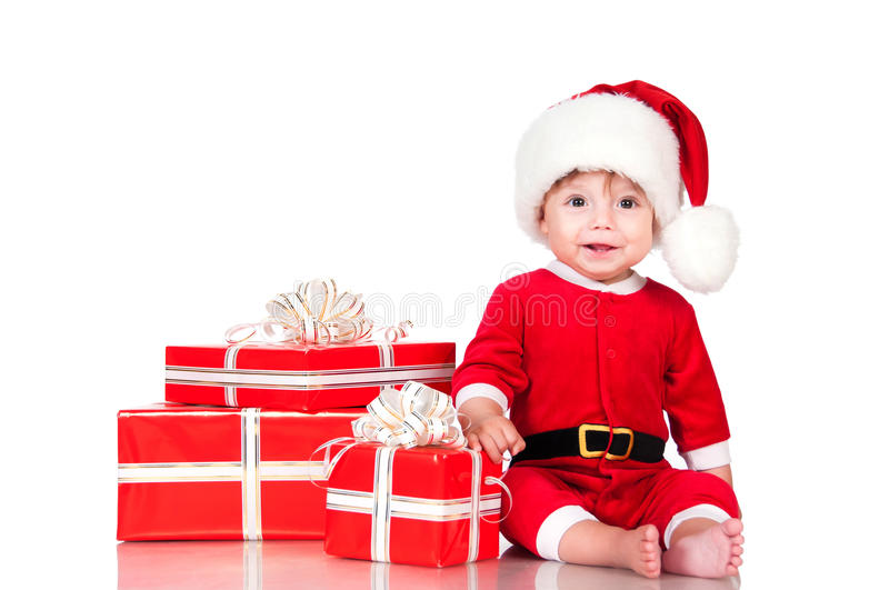 Cute little boy Santa with gift boxes on a white background. Happy New Year and christmas holidays royalty free stock images