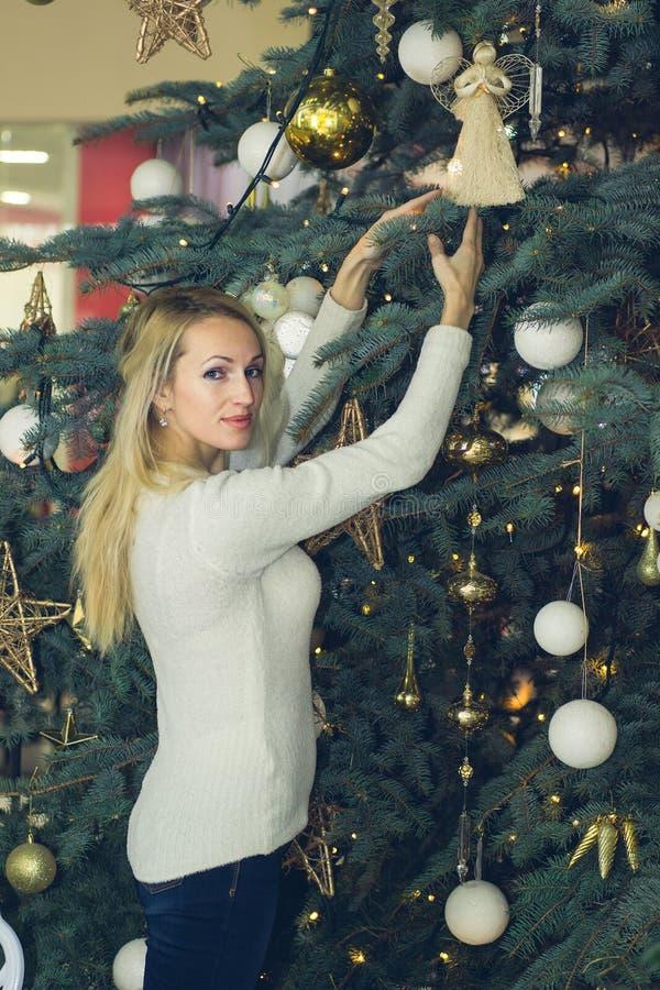 Cheerful long hair woman celebration Christmas. Cheerful blonde long hair woman celebration Christmas royalty free stock image