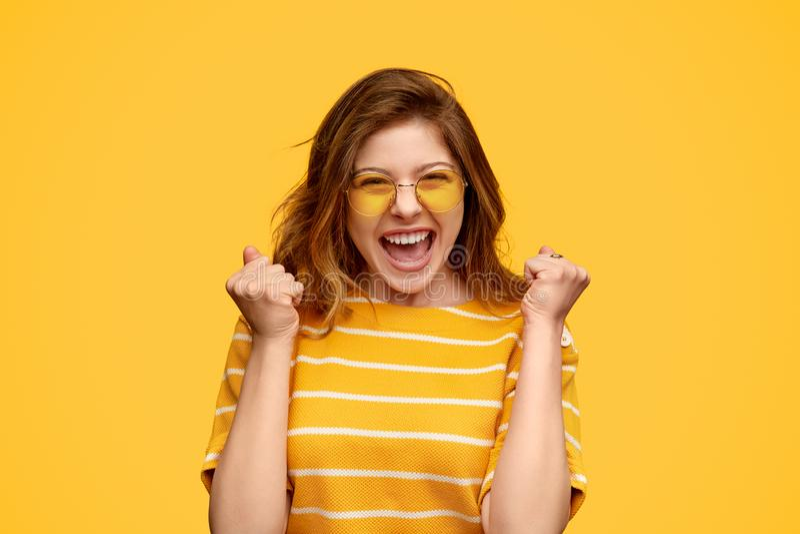 Cheerful lottery winner celebrating success stock photo