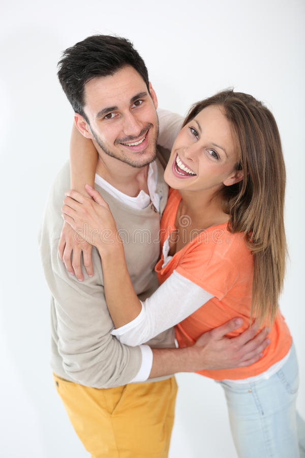 Cheerful loving couple smiling. Cheerful lovely couple smiling at camera stock image