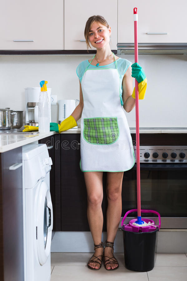 Free Cheerful Maid Cleaning At Kitchen Royalty Free Stock Photography - 79208757