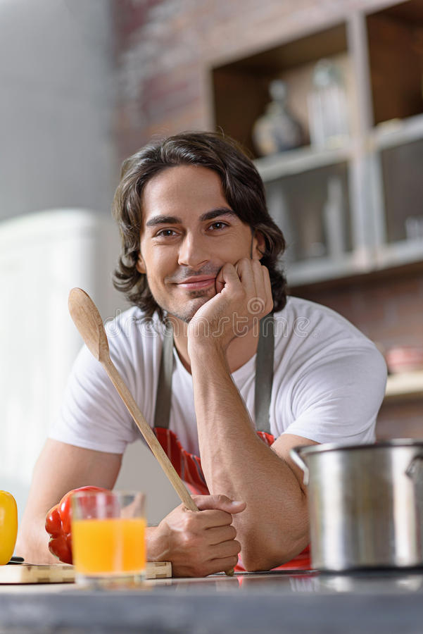 Cheerful male chef preparing healthy food stock photos