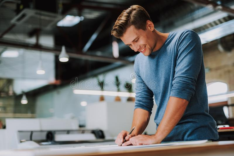 Cheerful male designer being involved in drawing royalty free stock photos