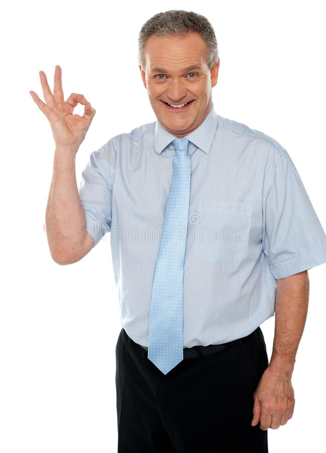 Cheerful Male Executive Showing Okay Sign Royalty Free Stock Photos
