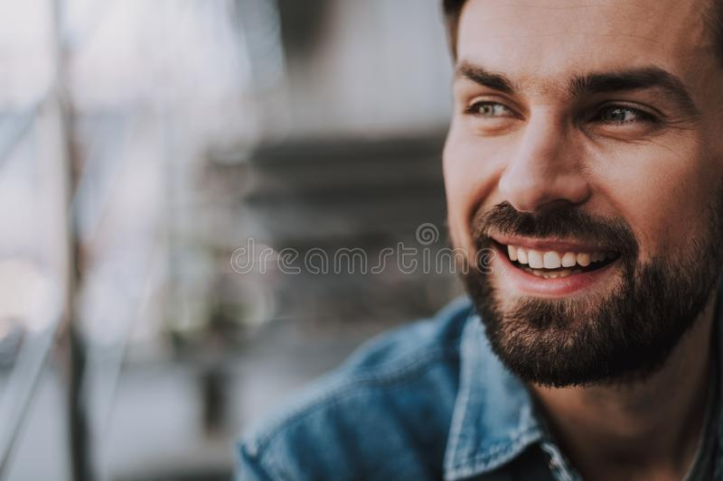 Cheerful male having leisure at the street royalty free stock image