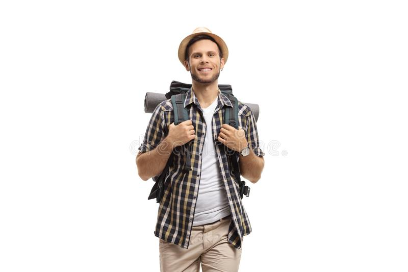 Cheerful male tourist with a backpack royalty free stock photography