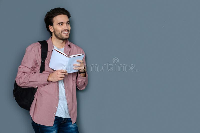 Cheerful male tourist reading a tour guide royalty free stock photos