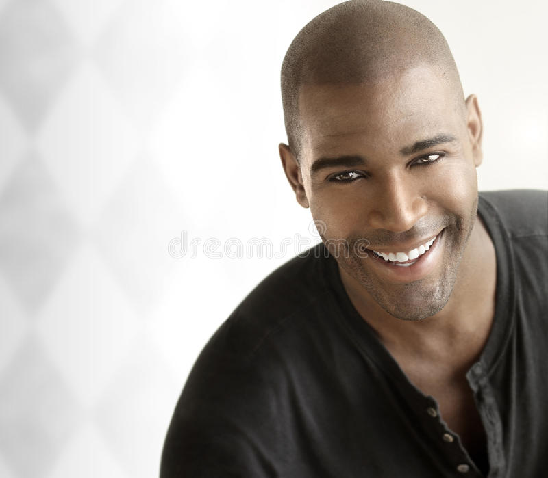 Cheerful man. Portrait of a cheerful young smiling casual man against white modern background with copy space stock image