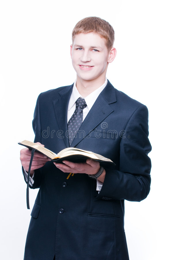Cheerful man with Bible. Isolated on white background stock photos