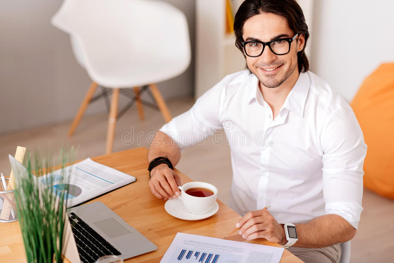 Cheerful man drinking tea stock images