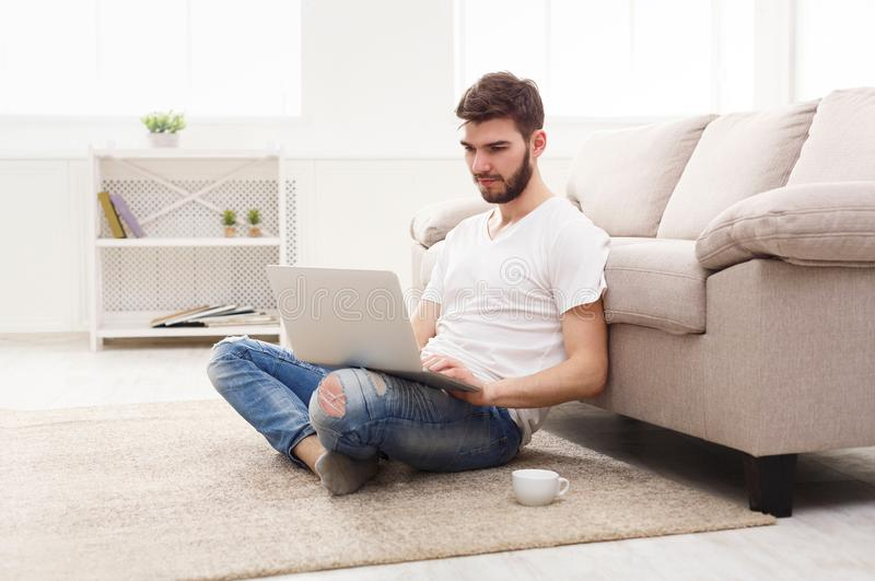 Cheerful man with laptop indoors royalty free stock images
