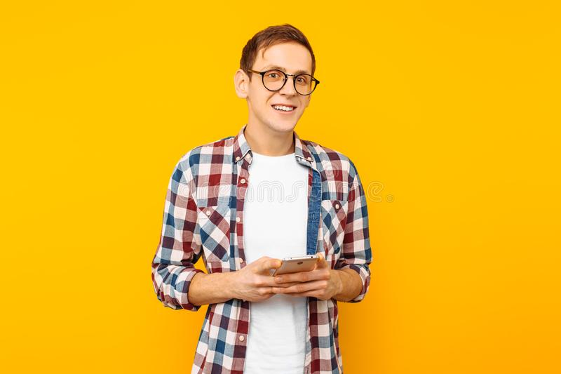 Cheerful man received a message on the phone royalty free stock photos