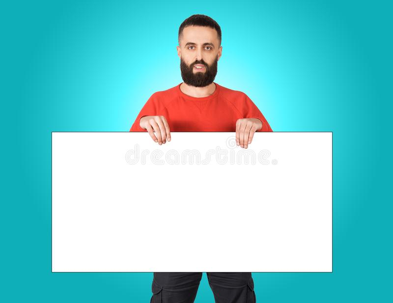 Cheerful man showing big board of your advertisement royalty free stock photography