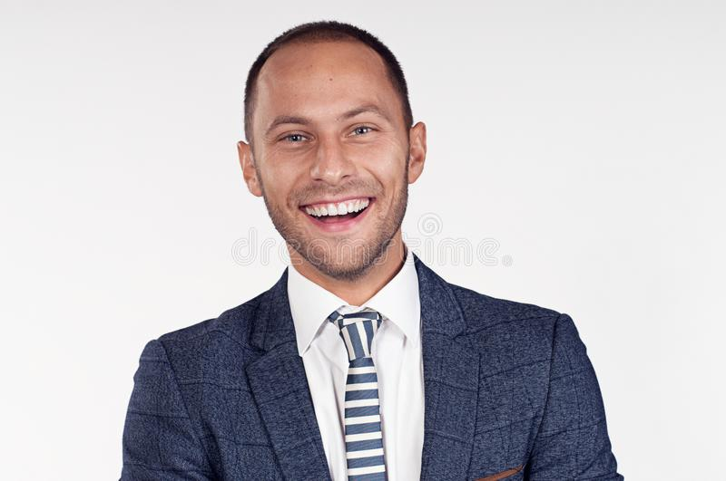 Cheerful man in a suit with a tie. White background. Isolated image. royalty free stock photos