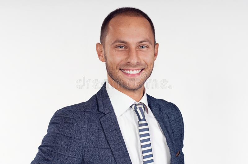 Cheerful man in a suit with a tie. White background. royalty free stock photography