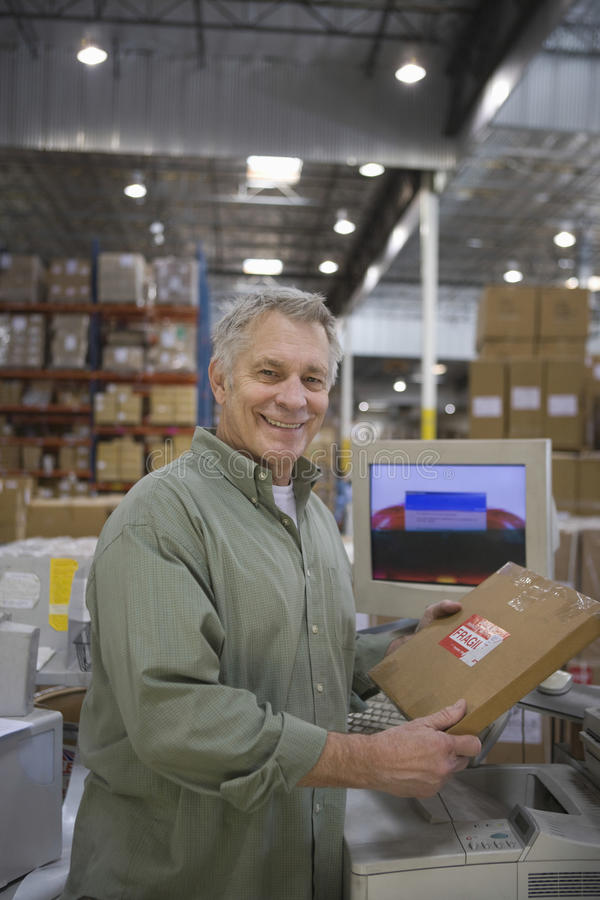 Cheerful Man Working In Warehouse royalty free stock images