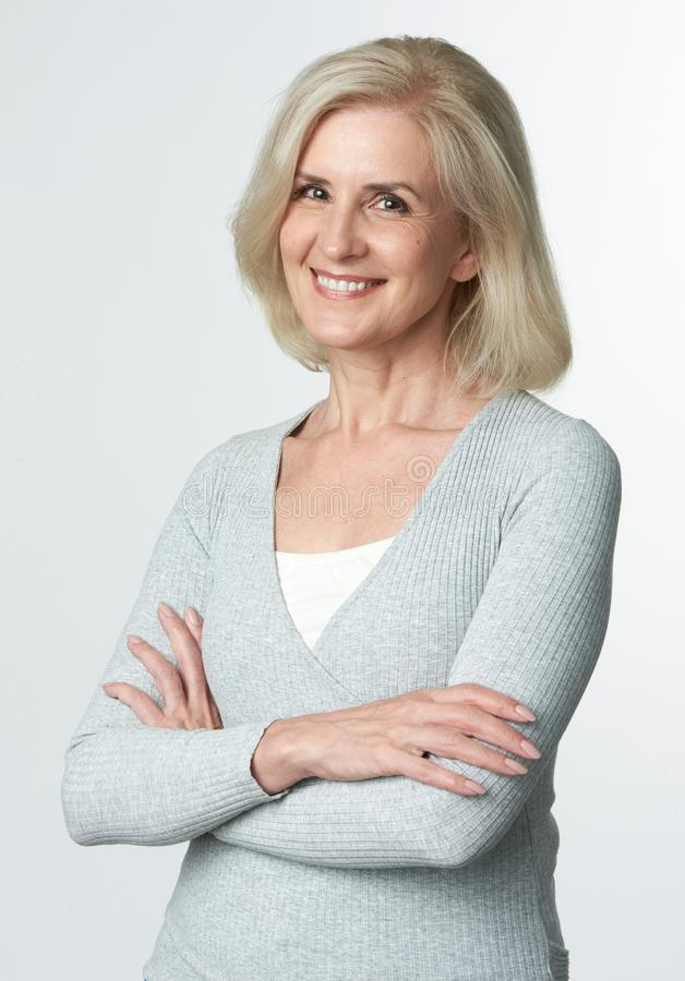 Cheerful mature blonde woman royalty free stock photos