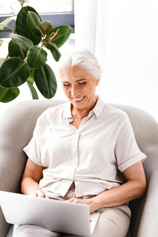 Cheerful mature business woman working stock image