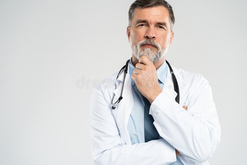 Cheerful mature doctor posing and smiling at camera, healthcare and medicine. stock photo