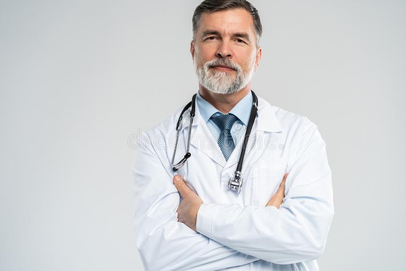 Cheerful mature doctor posing and smiling at camera, healthcare and medicine. stock photography