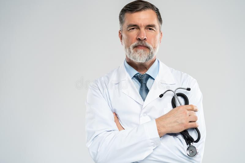 Cheerful mature doctor posing and smiling at camera, healthcare and medicine. stock image