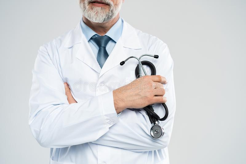 Cheerful mature doctor posing and smiling at camera, healthcare and medicine. royalty free stock photography