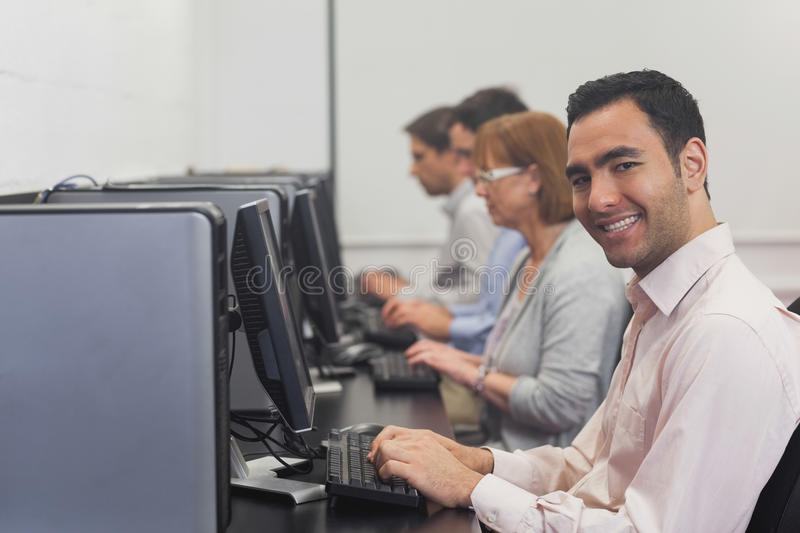 Download Cheerful Mature Student Sitting In Computer Class Stock Photo - Image: 35781468