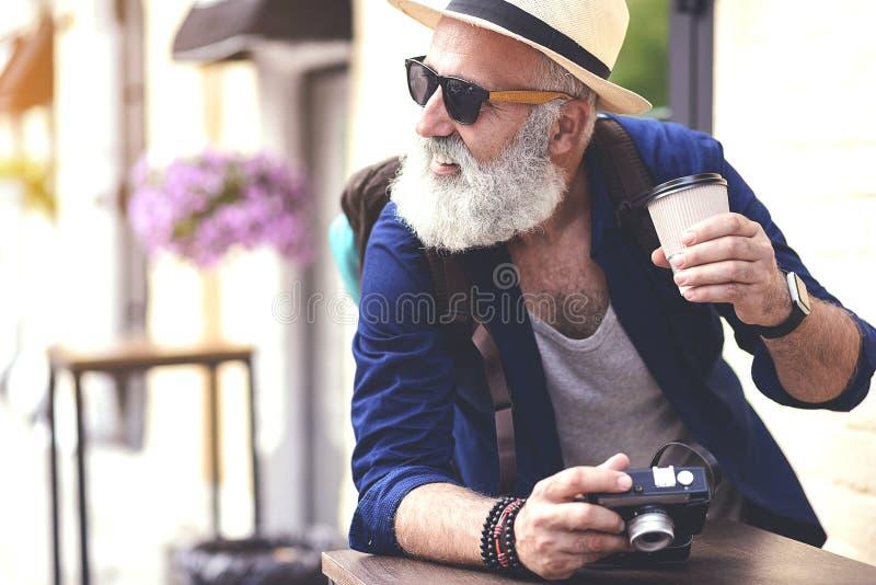 Cheerful mature tourist having break outside stock image