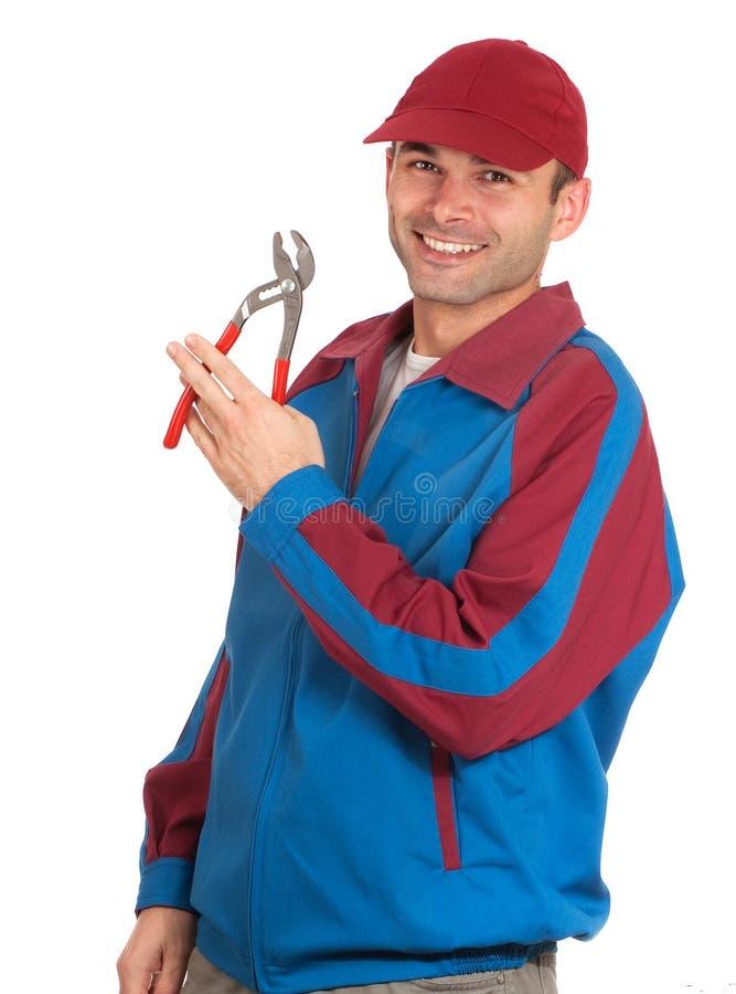 Download Cheerful mechanic stock photo. Image of uniform, plumber - 19911058