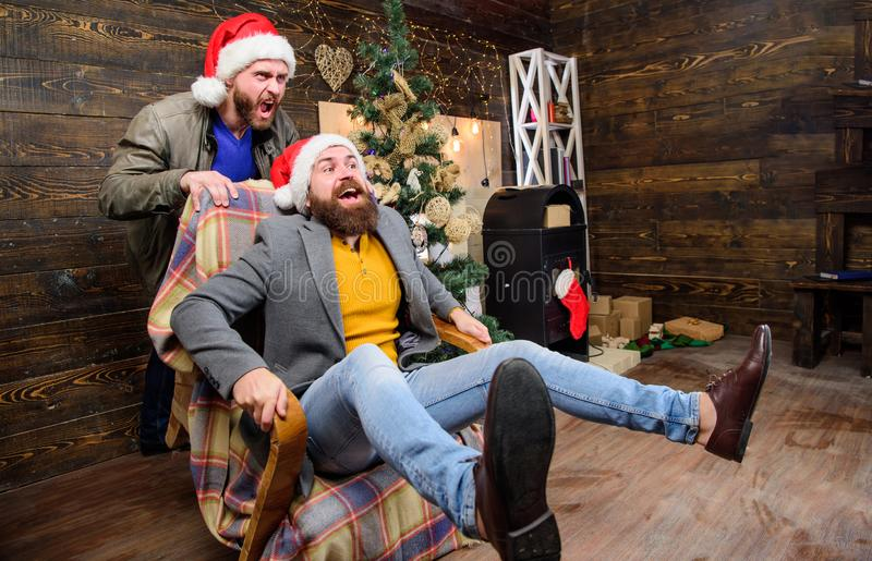 Cheerful men having fun at home. Christmas fun. You will never be bored if you have such friend. Break into new year royalty free stock images