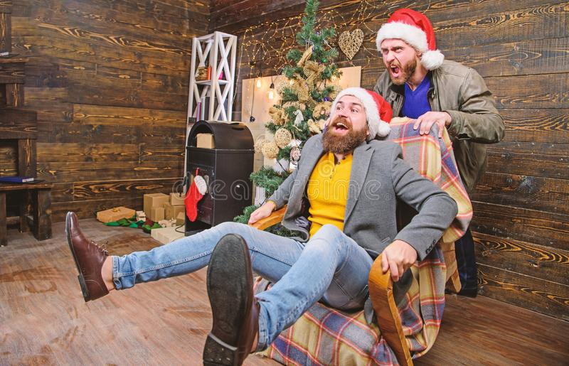 Cheerful men having fun at home. Christmas fun. You will never be bored if you have such friend. Break into new year stock photo