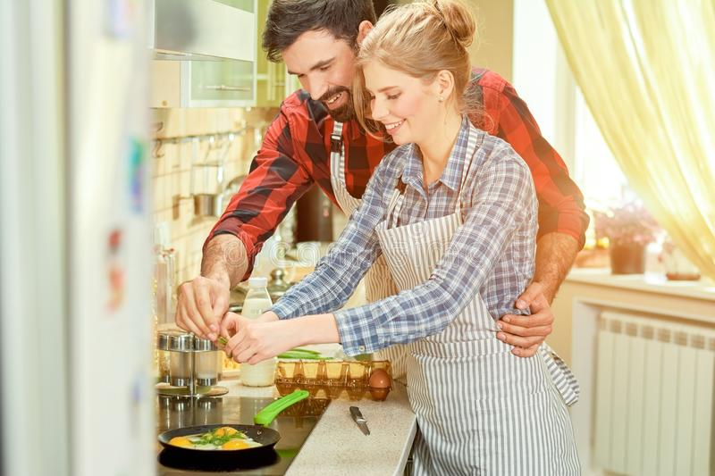 Cheerful man and woman cooking. stock photography