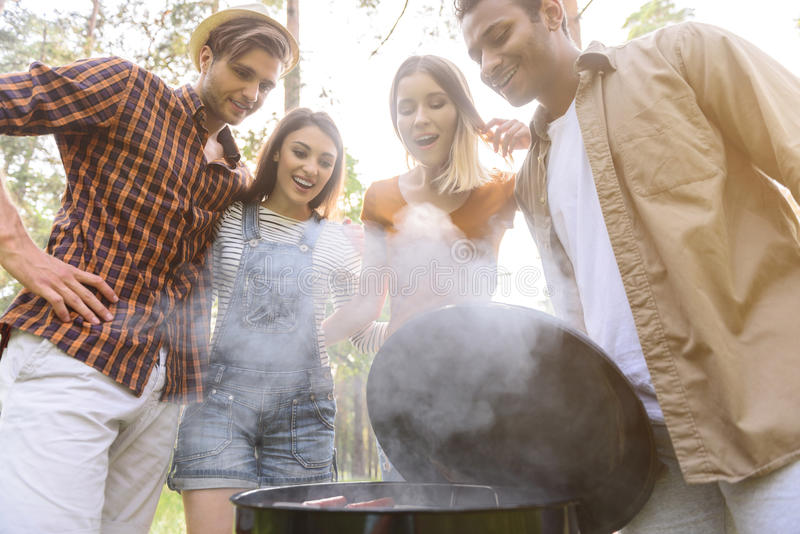 Cheerful men and women want to eat stock photo