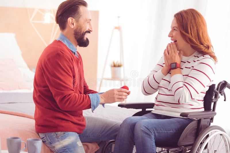 Cheerful mid aged man making a proposal royalty free stock photography