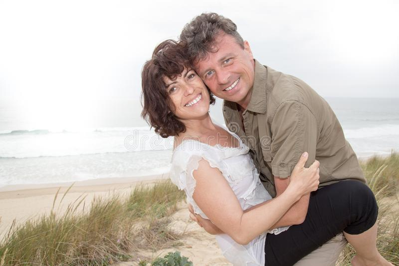 cheerful middle age couple in love on beach royalty free stock image